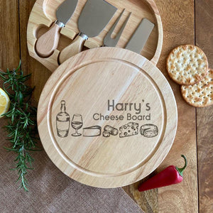 "A personalised round cheese board with a set of cheese knives. The board features a cheese illustration and the words ""Harry's Cheese Board"""