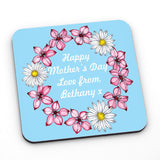 A personalised blue flowery coaster with a personal message in white lettering