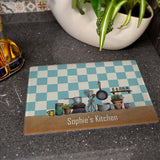 A personalised kitchen illustration glass chopping board