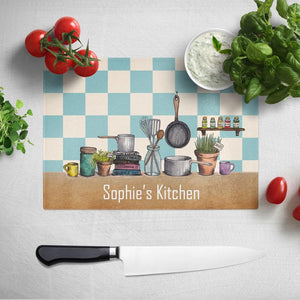 "A personalised chopping board with illustrations of kitchen items on and the text ""Sophie's Kitchen"""
