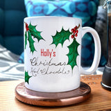 a personalised Christmas mug with a holly berry design