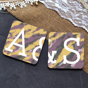 A personalised coaster set in yellow and purple featuring a couple's initials