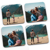 A set of 4 photo coasters with family holiday photos printed on them