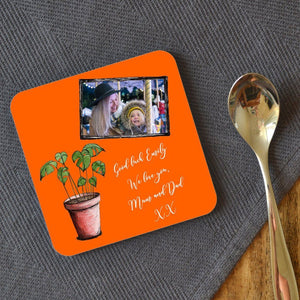 a personalised orange coaster featuring a message and family photo
