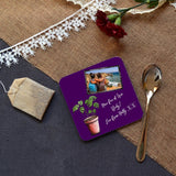 a personalised purple coaster featuring a photo of friends and a message in white text