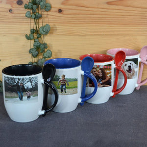 Four personalised photo mugs with coloured handles, colours are black, blue, red and pink. Each mug has a photo printed on it.