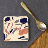 "A printed terrazzo coaster personalised with the initials ""R&D"""