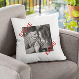 "A personalised cream cushion with a black and white photography of 2 people printed on it, the names ""Steve"" and ""Katie"" are printed in red block capital lettering"