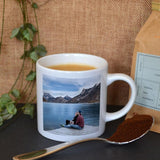 A personalised white espresso cup with a photo printed on it