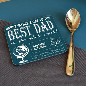 "A personalised coaster with a Father's Day message on it and a globe icon next to the words ""best dad in the world"""