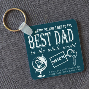 A personalised square father's day keyring with a globe and a personalised message in fancy typography