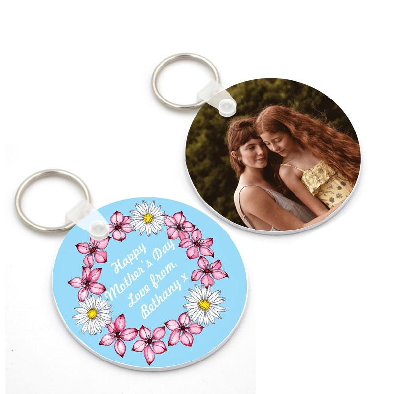 A personalised Mother's Day keyring with flowers and a message on one side an a photo on the other side