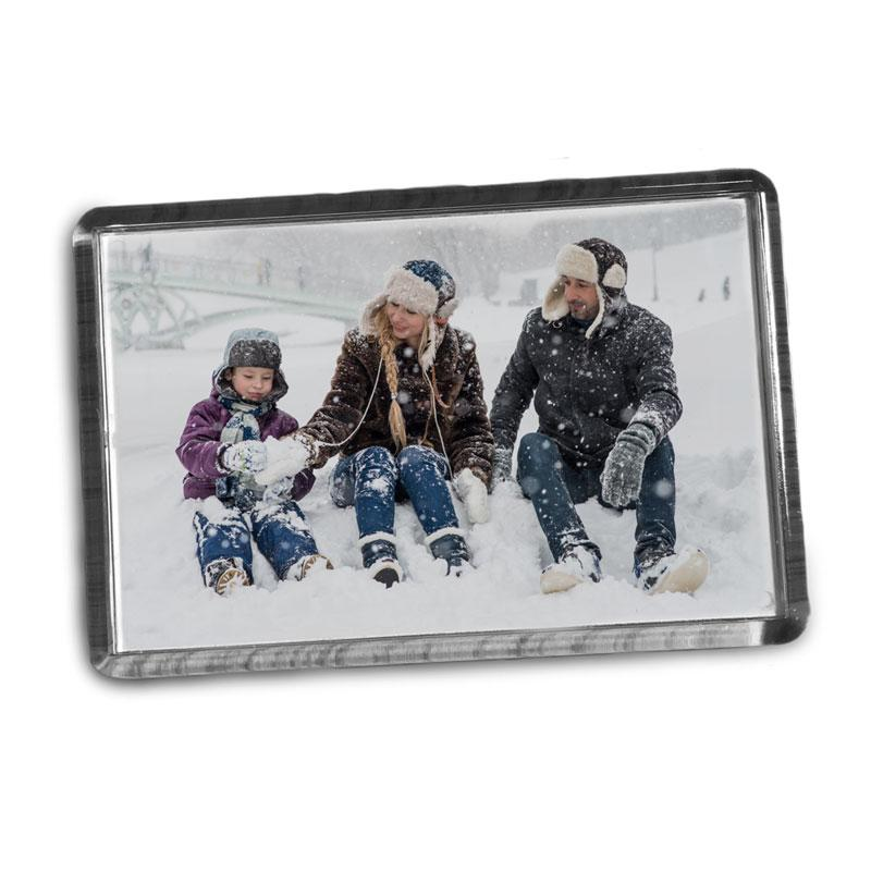 A personalised plastic rectangular fridge magnet displaying a family photo