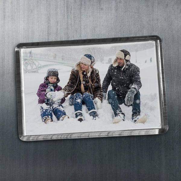 A personalised rectangle fridge magnet with a photo of a family on it