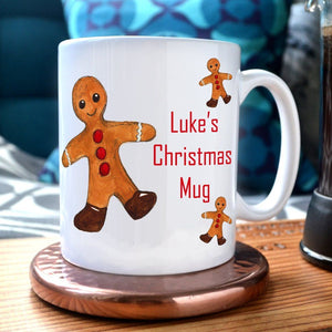 A personalised Christmas mug with a gingerbread design