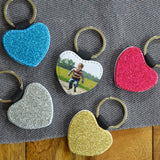 Personalised photo keyrings with glitter backs in pink, gold, silver and blue.