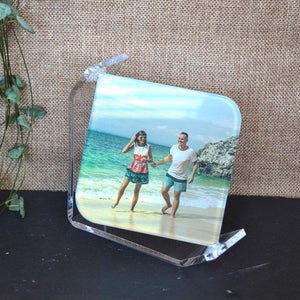 A personalised photo glass display with perspex frame