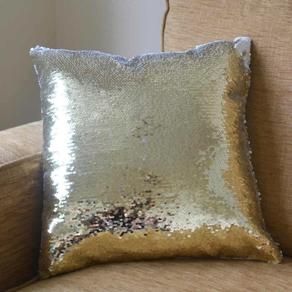 A gold sequin cushion with its secret message hidden