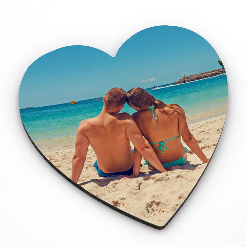 Personalised heart coaster with a photo of a couple on a beach printed on it