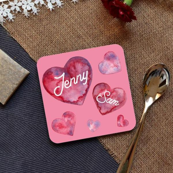 A personalised pink coaster with a heart pattern
