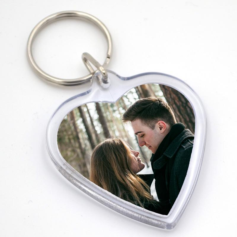 A personalised plastic photo keyring containing a photo of a couple
