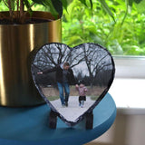 A personalised heart shaped slate plaque with a photo of a dad and his daughter printed on it.