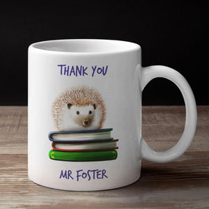"A personalised mug with a hedgehog on a pile of books and the words ""thank you Mr Foster"""