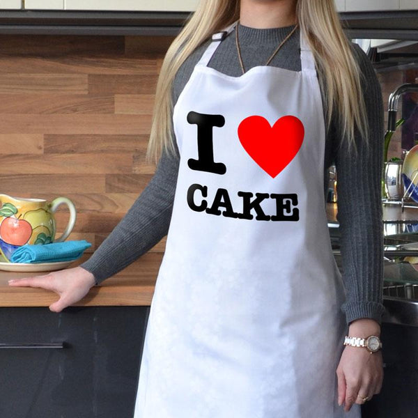 "Personalised white apron with ""I Heart Cake"" printed on it"