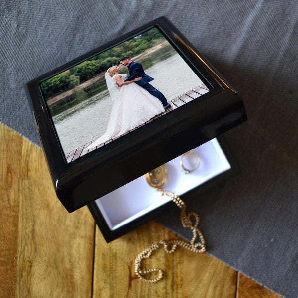 A black jewellery box with a photo printed on the lid