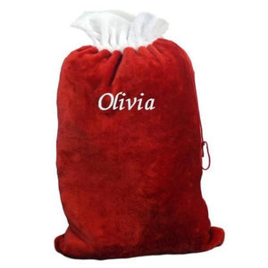 "A personalised red and white Christmas sack made from velvet. The sack has the name ""Olivia"" embroidered on the front in white lettering."
