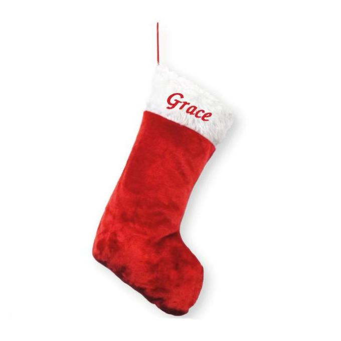 "A classic personalised Christmas stocking in red and white. The stocking has the name ""Grace"" embroidered in red on the fluffy white top section."