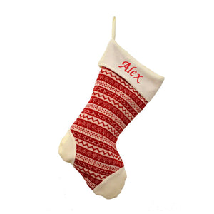 "A red and cream stocking made from a knitted fabric with a Nordic pattern woven into it. The top of the stocking is cream with the name ""Alex"" embroidered in red text."