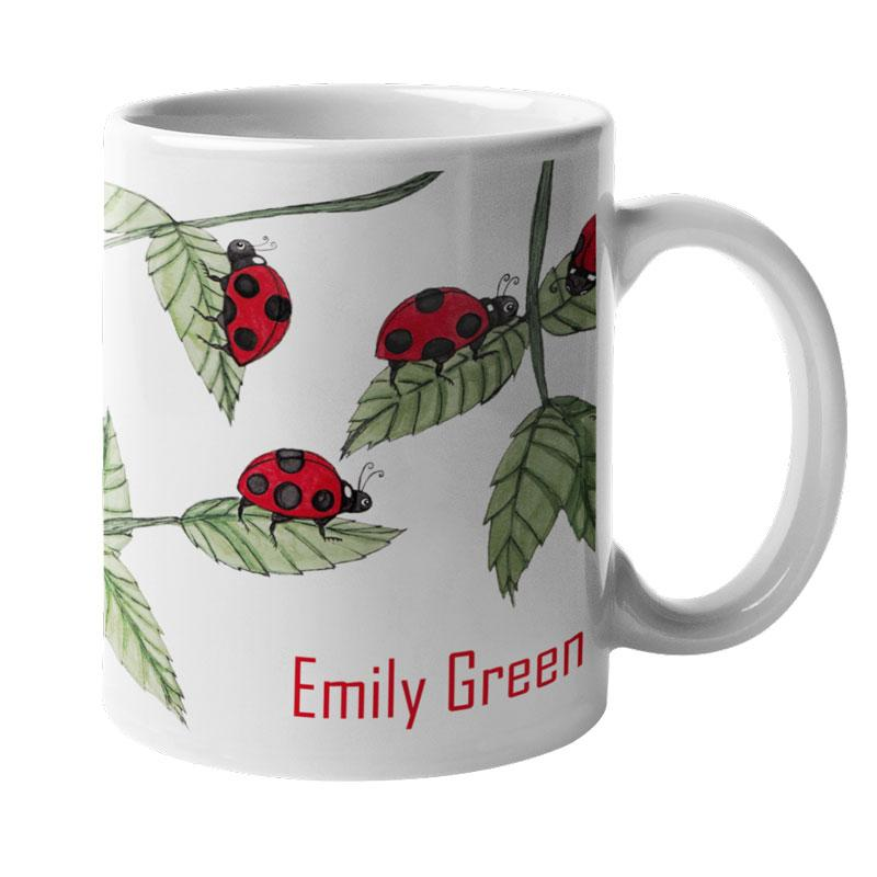 A personalised white mug with a ladybird pattern