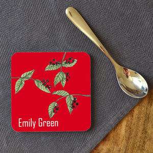 "A personalised square caster with a ladybird pattern, the coaster is personalised with the name ""Emily Green"""