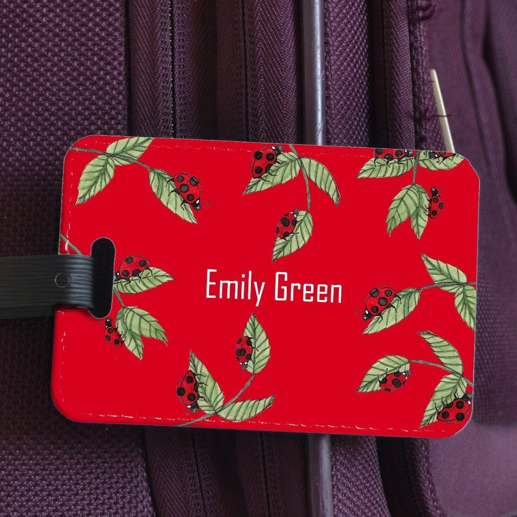 "A personalised luggage label with a ladybird design. The design includes a name which reads ""Emily Green"""