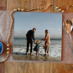 A personalised large square photo placemat with an image of a family printed on it