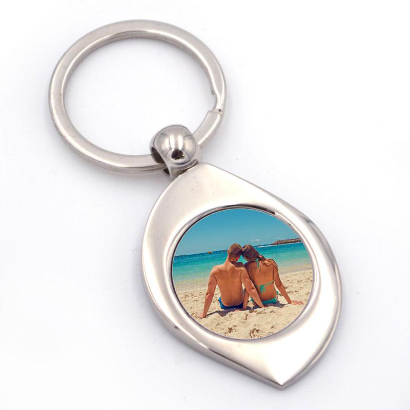 Personalised teardrop shaped keyring with a photograph printed in it