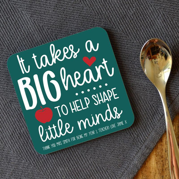 "Personalised coaster for teachers with the message ""it takes a big heart to help shape little minds"" in white lettering on a teal background."
