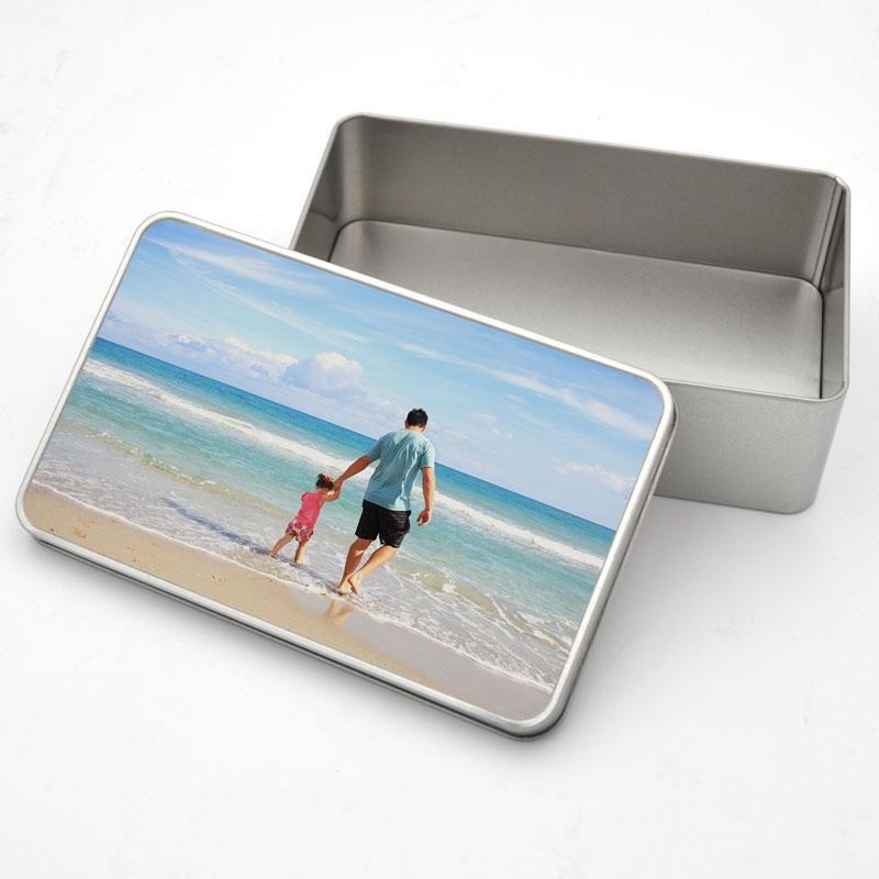 A personalised metal tin with a photo of a father and daughter printed on the lid
