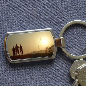 A personalised metal keyring with a family photo inside. The keyring is in a rectangular shape and the personalised element is the photograph.