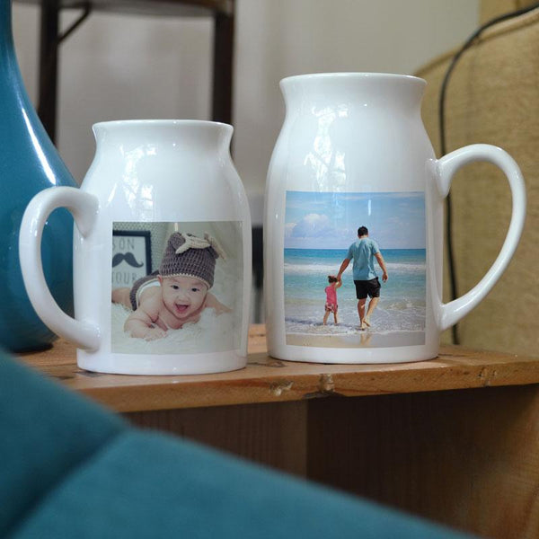 Personalised milk jug shaped mugs with family photos printed on them. One is small and one is large.