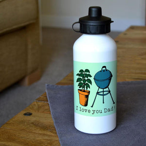 A personalised white metal water bottle with a picture of a plant and a barbecue and a message underneath in black lettering.