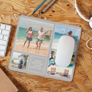 "A personalised mouse mat with a collage of holiday photos printed on it along with a message reading ""Happy birthday James, love you x"""