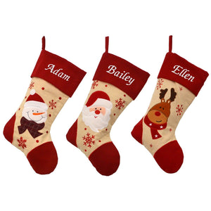 3 personalised Christmas stockings, made from natural calico with red felt tops, heals and toes. The stockings are personalised with white embroidery names and have wither a Santa a reindeer or a snowman design.