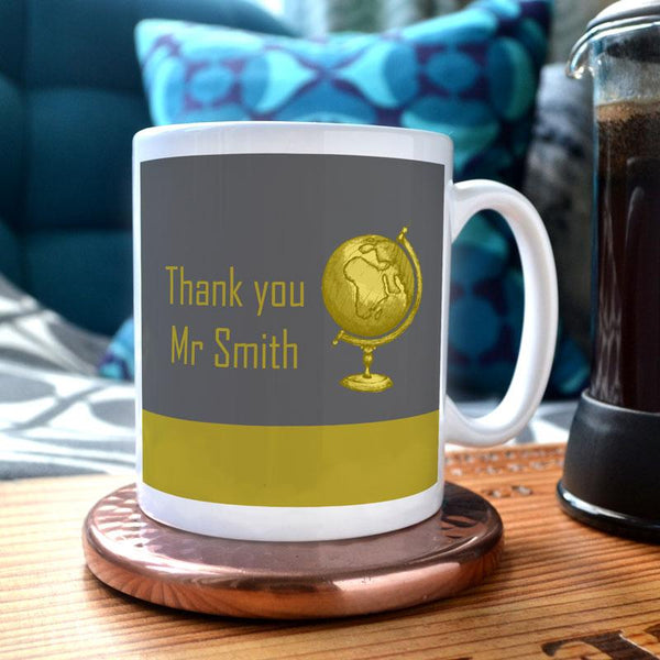 A mug with a yellow and grey design and a personalised message. The mug design includes a yellow globe.
