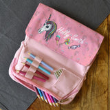 An image of the inside or the personalised pink unicorn pencil case. The photo shows that the pencil case has lots of compartments