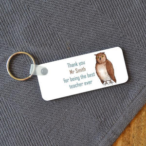 "A rectangular key ring with a design which features an illustration of an owl and text which reads ""thank you Mrs Smith for being the best teacher ever"""