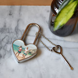 A personalised metal padlock in a heart shape with a photo of a couple printed on it.