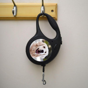 A personalised dog lead in black. The plastic handle has a photo of a dog printed on it.