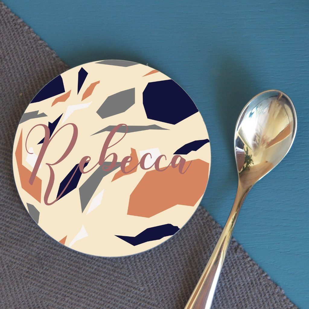 "A personalised terrazzo patterned round coaster, the design is personalised with the name ""Rebecca"""